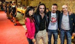 Da sinistra: la dress designer Lucia Dall'Aquila insieme ai fratelli Francesco, Mauro e Flavio Celli (Per gentile concessione)